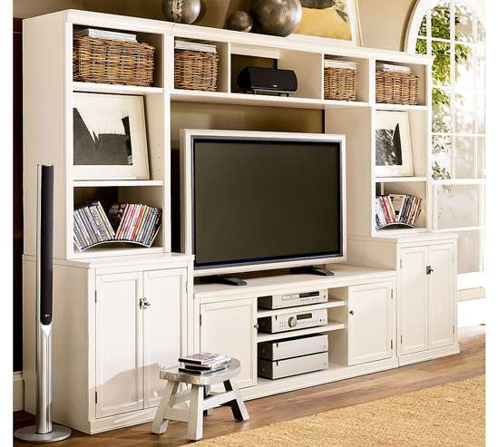 Bridged hardwood media suite Comprised of several different units, the Logan media system can be customized to fit any space. Available in three finishes and two sizes, the unit also contains cord cut-outs in the back to help with wire management.