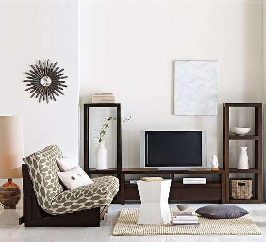 Modern media collection This media storage unit is comprised of two seperate pieces: a tower and a stand with a back panel that can be adjusted to suit your needs. This collection offers two drawers for hidden storage and plenty of display space.
