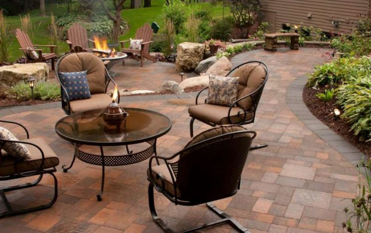 Paver Patio With Neutral Tufted Cushions