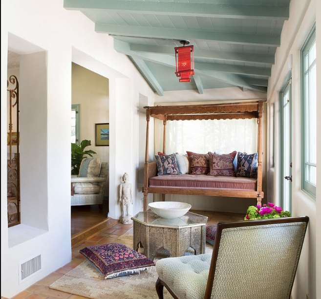 Spanish Colonial influences dominate this breezy sunroom