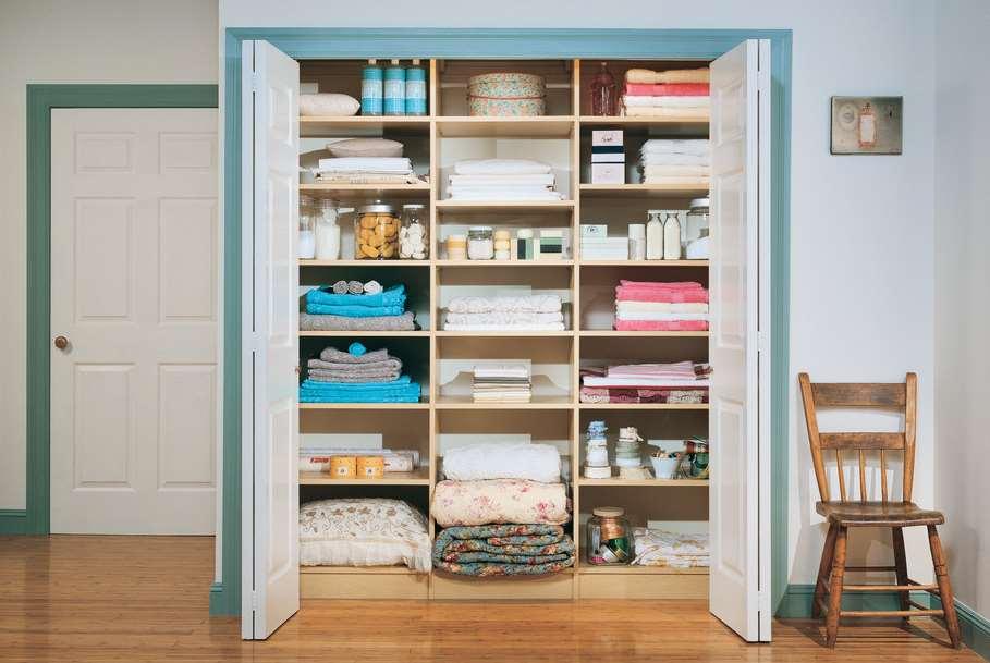 white linen storage cabinet