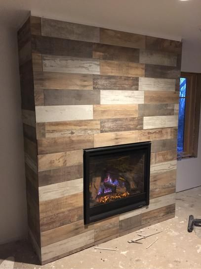 Image result for wood panels fireplace tiles