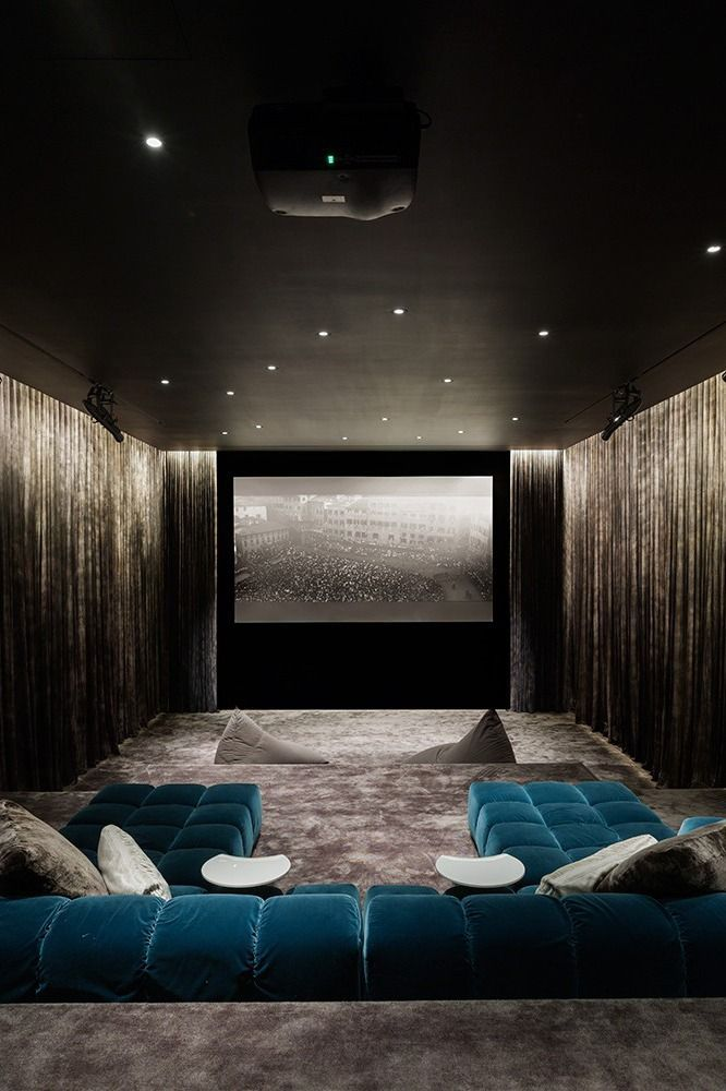 A large bed in a room Description generated with very high confidence