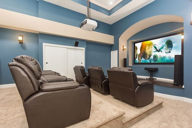 A living room filled with furniture and a flat screen tvDescription generated with very high confidence